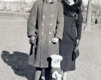 Vintage photo 1930 Couple Coats Little WHite Dog in Superman Cape Sits up for Portrait photo