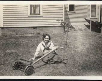 Vintage photo Young Lady Sitting Down on the Job w Lawnmower in Grass 1917