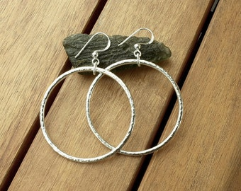 """Large silver hoop earrings 