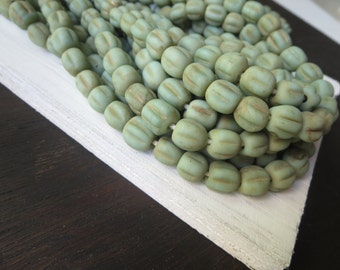 12 matte green glass beads ,  round lampwork beads, melon wavy, rustic gritty aged look , indonesian  -  9 to 11mm  / 12 beads, 6a8-11