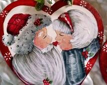 Merry Mistletoe Kissmas! Santa is kissing his Mrs. Santa, Ornament.