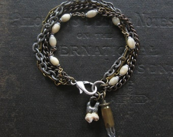 Howl - Antique Rosary Beads Coyote Tooth and Crystal Bullet Bracelet