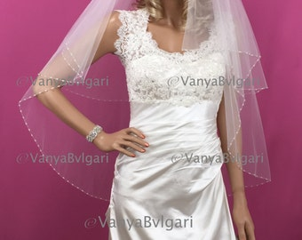 Bridal veil in two tier with beaded edge in fingertip length in classic style in light Ivory color with gathered top on a comb