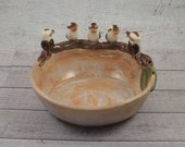 Ceramic 5 kookaburra pin or trinket dish with gumleaves with pale apricot tones by Anita Reay