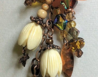 Copper, pottery, crystals and flowers on cord set