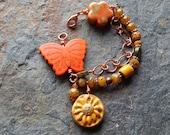 Butterfly bracelet, multi strand bracelet, woodland fantasy, statement bracelet, chunky bracelet, indie, boho, orange,yellow, butterflies