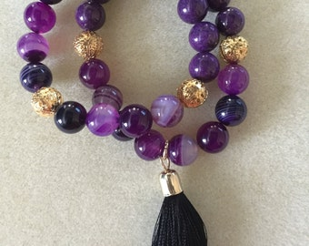 Shades of Purple and Gold Filigree beaded, stackable bracelets with Black Tassel