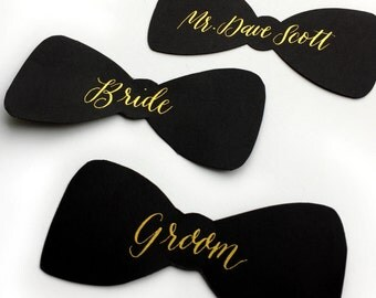 "Black bow tie place cards with gold calligraphy; 4"" wide; custom calligraphy included; wedding or any special occasion escort cards"