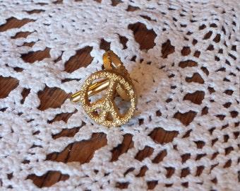 Dante gold peace sign cuff links