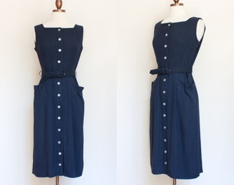 1950s tailored navy afternoon dress / 50s dark blue dress with pockets / S