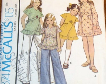 McCall's 4374 Girls Empire Prairie Dress, Smock Top, Hem Ruffle, Back Tie, Vintage 1970s Sewing Pattern Size 7 Chest 26 Uncut Factory Folds