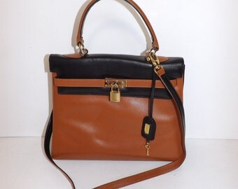 Vintage real leather tan brown and black kelly grab handbag bag by Lacrocce with working lock and key