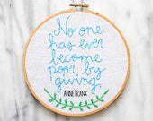 hand embroidered Anne Frank giving quote in a 6 inch wooden hoop