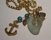 SEA GLASS Necklace; Nicely frosted English glass. Gold-tone chain, wire work, charms include Anchor, 'made with love' heart,tiny stars shell