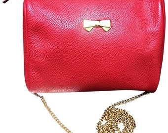 Vintage Nina Ricci red leather mini pouch purse with golden chain shoulder strap. Golden logo bow motif. Perfect party purse