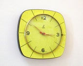 French 1950-60s Atomic Age JAZ Bright Yellow - Black Stripes -  Formica Wall Clock - Freeform Shape - Good Working Condition