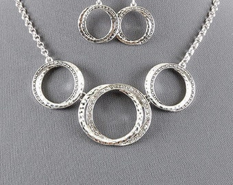 Silver Rhinestone necklace and earrings set! Great look for the holidays!