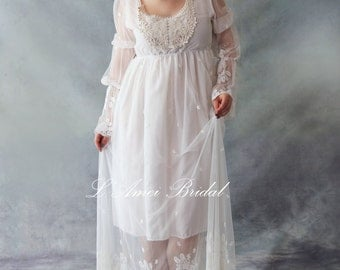 Custom made vintage style embroidered lace wedding dress with long hem and sleeves and cotton lace neckline