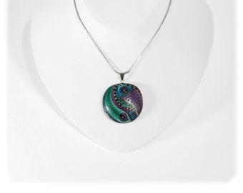 Colorful stylish handmade pendant with peacock feather pattern. One of a kind...