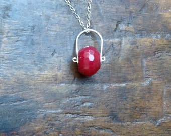 Long necklace with a ruby wheel and hammered fine silver pendant with a sterling silver chain
