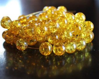 80 approx. golden yellow, 10 mm crackle glass beads, 1.5 mm hole, round and smooth, light reflective