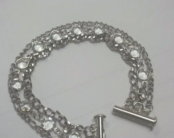 Triple strand swarovski and chain bracelet