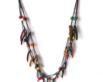 Brightly coloured coconut shell necklace. Spikey triangles pointed shapes. Triple Three Loop Style With Closure.