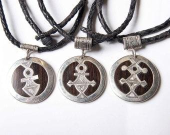 Ebony and silver Tuareg crosses
