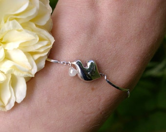 Bird bracelet in white gold and diamond pearl
