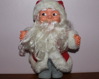 Ho, ho ho Merry Christmas vintage retro Santa Claus doll whose clothes can be taken off except boots.