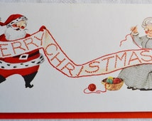 Vintage Christmas Card - Santa and Grandma Sewing Stitching Merry Christmas Banner - Used