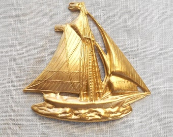 1 brass stamping, a sail boat, a nautical ornament, pendant, or charm, 42mm x 30mm, made in the USA C1501