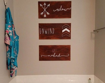 Relax, Unwind, Get Naked bathroom signs