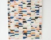 Bustle Tea Towel. Blue, orange and green geometric print.