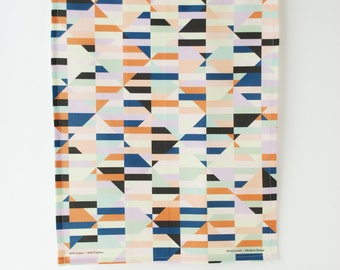 Bustle Tea Towel. Blue, orange and green geometric print.