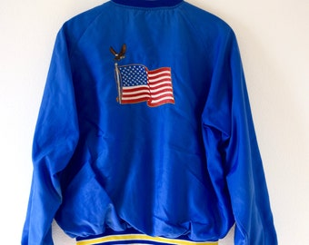 Vintage 70s 80s Butwin Royal Blue and Yellow Striped American Flag Nylon Bomber Jacket (size large)