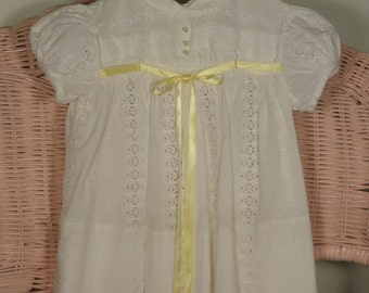 Sweet white eyelet dress with yellow bow at bodice. Size 12 month
