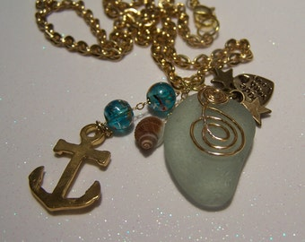 "SEA GLASS Necklace;frosted English glass.Gold-tone chain,wire work, charms: Anchor, Made w/love heart,tiny stars shell,20""+2"" drop    22.00"