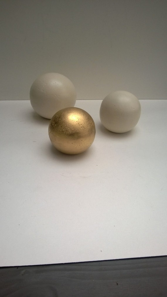 Decorative spheres set of three one large two small cast