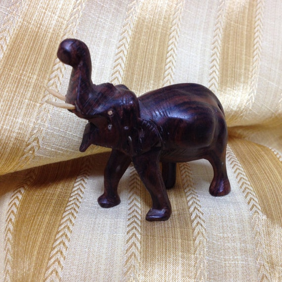 Hand carved wood elephant with tusksminiature
