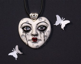 Sad heart moon pendant: hand painted cast sculpture portrait of a heart shape crying moon. Black and white heart necklace.