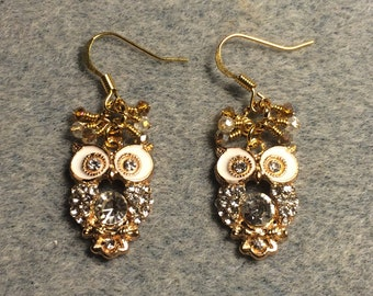 White enamel and rhinestone owl charm earrings adorned with tiny dangling amber and clear Chinese crystal beads.