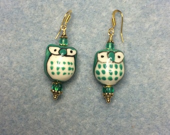Teal ceramic owl bead earrings adorned with teal Czech glass beads.