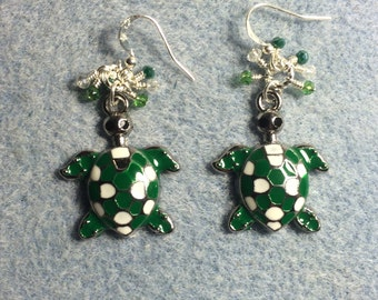 Green and white enamel turtle charm dangle earrings adorned with tiny green and clear Chinese crystal beads.