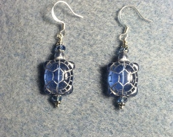 Light blue Czech glass turtle bead earrings adorned with light blue Chinese crystal beads.