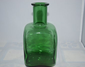 """Green glass vase with a square bottom. Great with or without flowers. 7.5"""" x 4"""""""