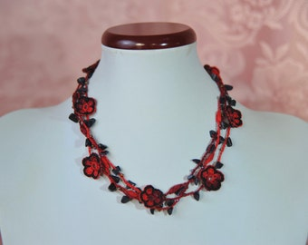 Crochet necklace with red flowers and natural stones black