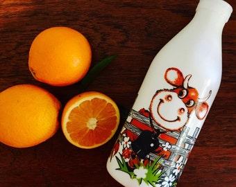1970s Egizia Italian made retro happy cow theme milk / juice bottle in white glass