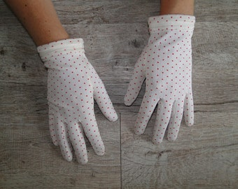 white vintage gloves with red polka dots