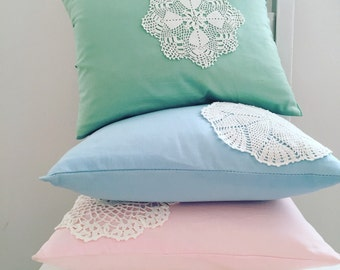 Decorative pillow with vintage doily